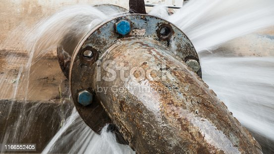 metal pipe with valve is leaking in water treatment plant