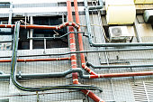 Metal pipes on building wall