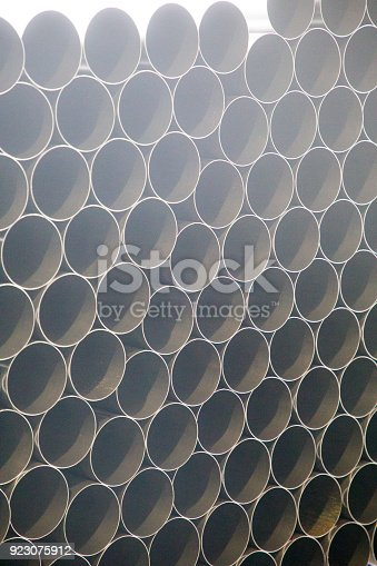 511814244istockphoto Metal pipes 923075912