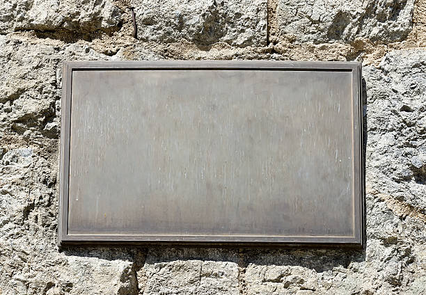 Metal Plaque on Stone Wall stock photo