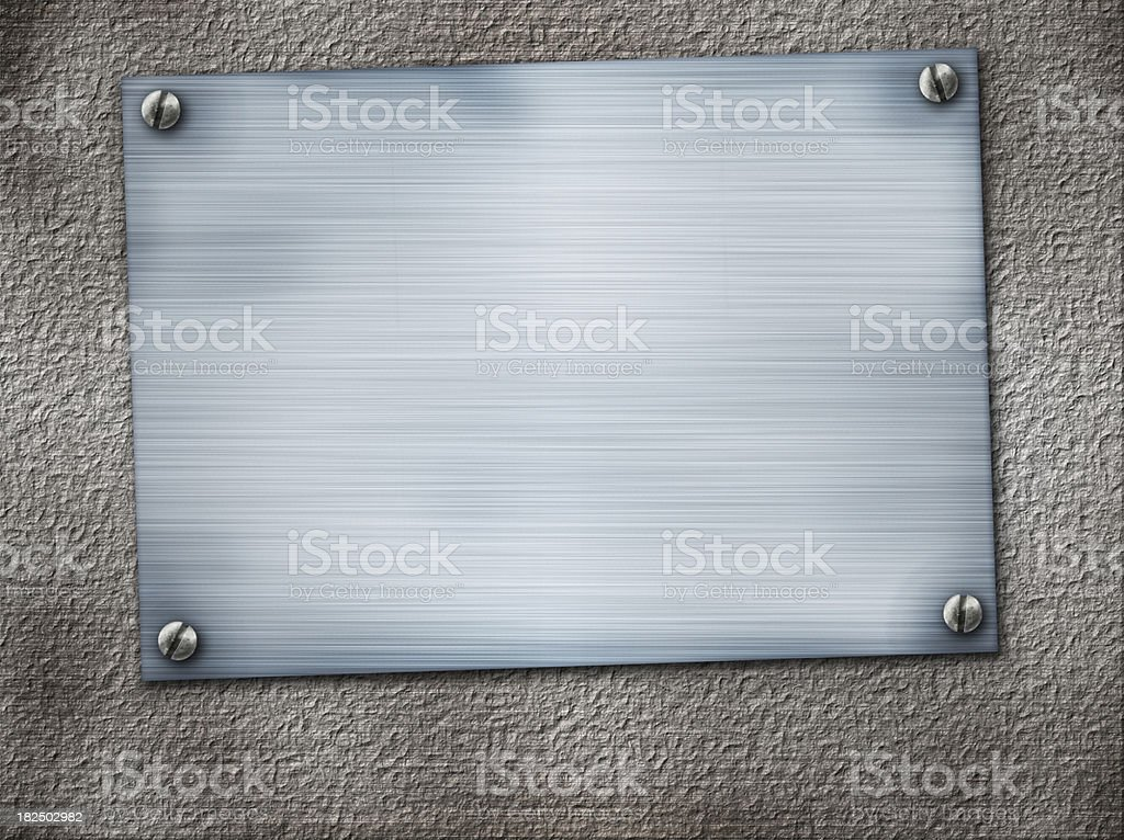 metal plate on concrete wall royalty-free stock photo