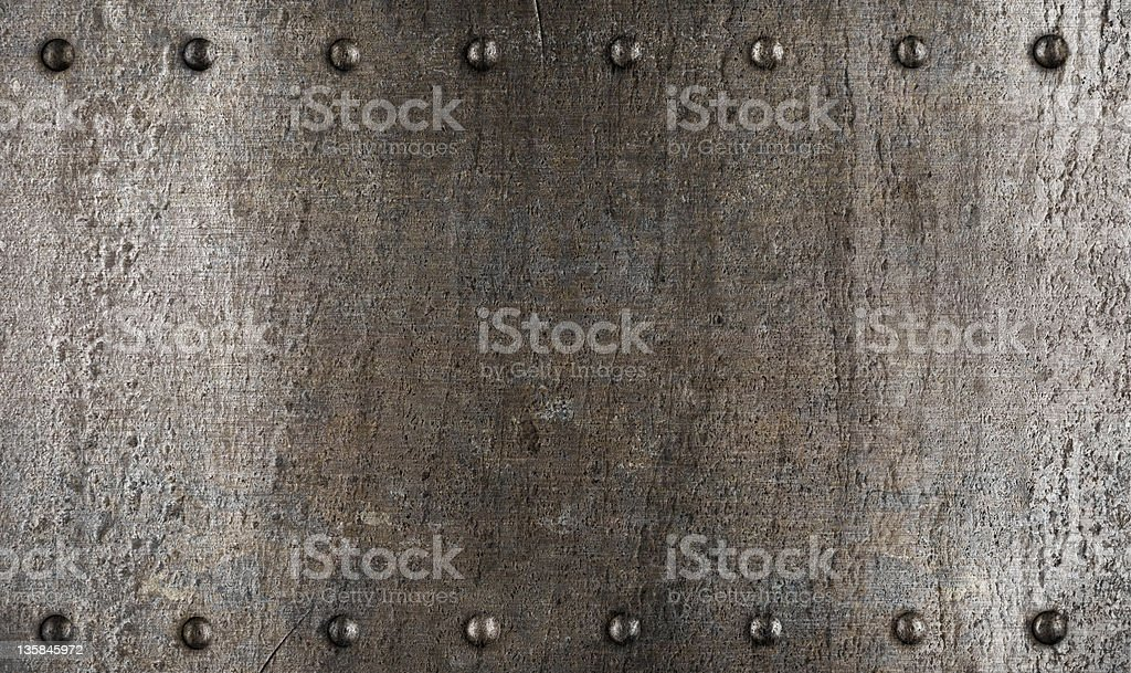 Metal plate or armour texture with rivets stock photo