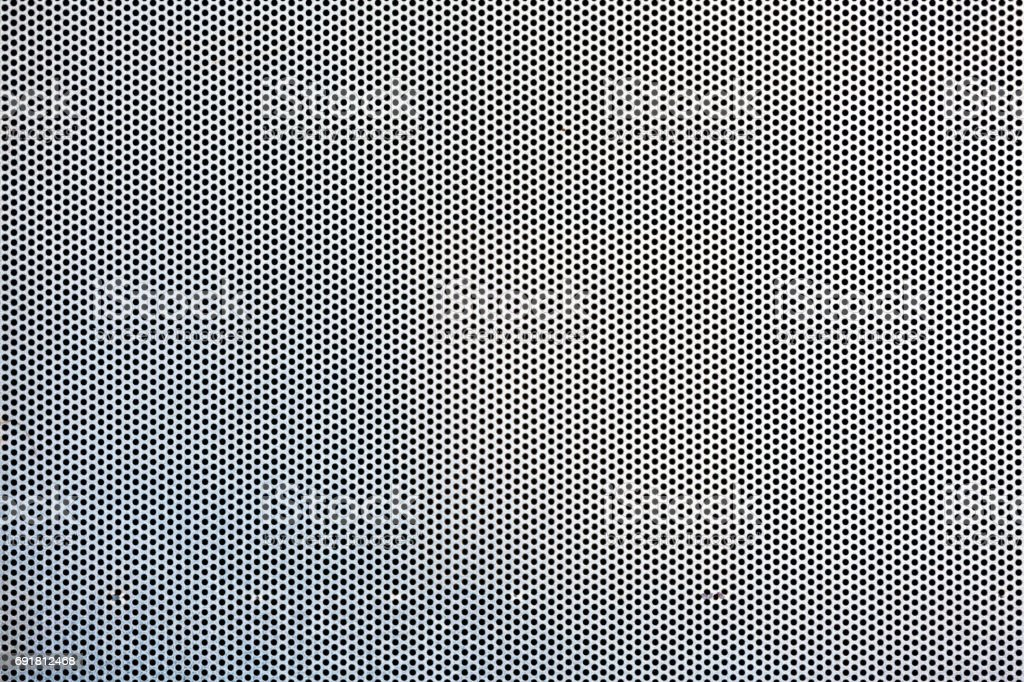 Metal plate with round holes stock photo
