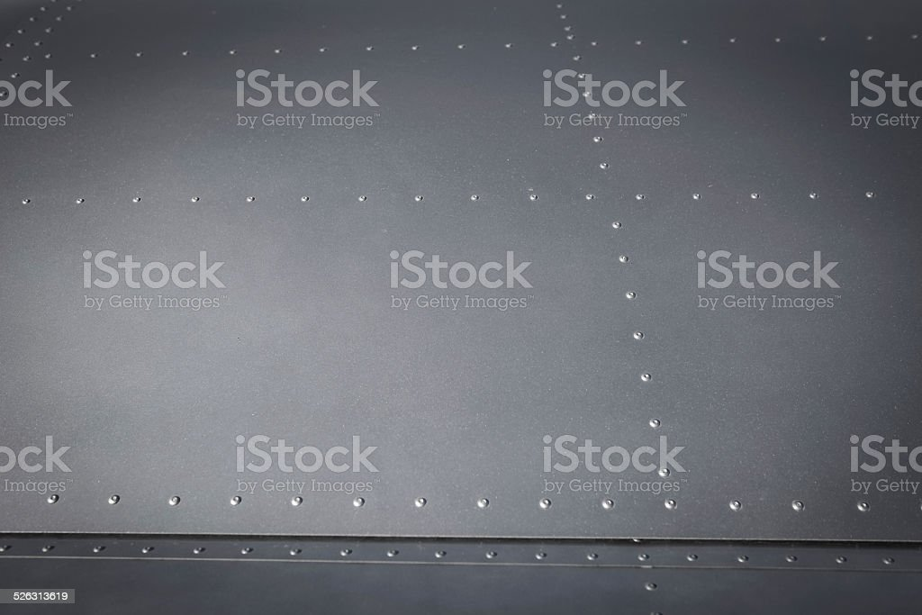 Metal plate with steel rivets stock photo