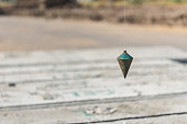 metal plumb line used in construction site