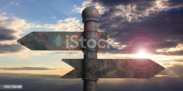 185884645istockphoto Metal pointer signposts on pole, isolated on sunset background. 3d illustration 1053768496