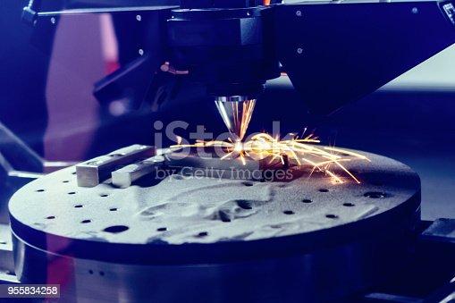 istock 3D metal printer produces a steel part 955834258