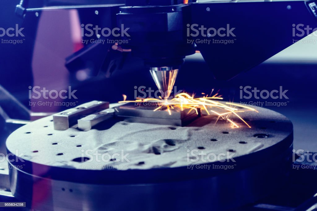 3D metal printer produces a steel part stock photo