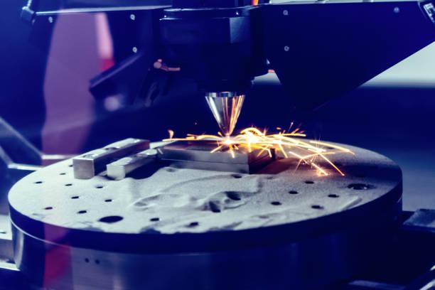 3D metal printer produces a steel part stock photo