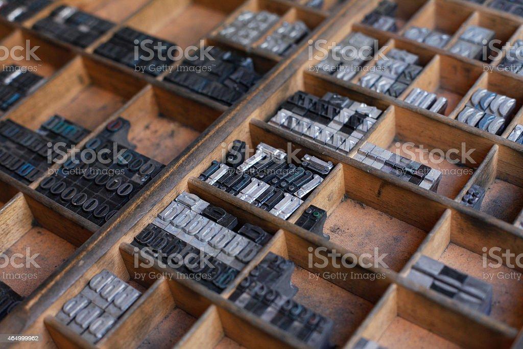 Metal printing press letters stock photo