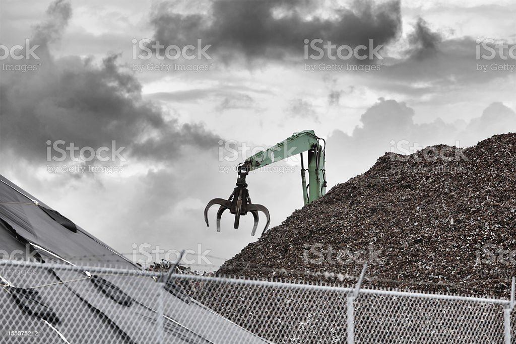 Metal Recycling Center Claw Grabber Crane royalty-free stock photo