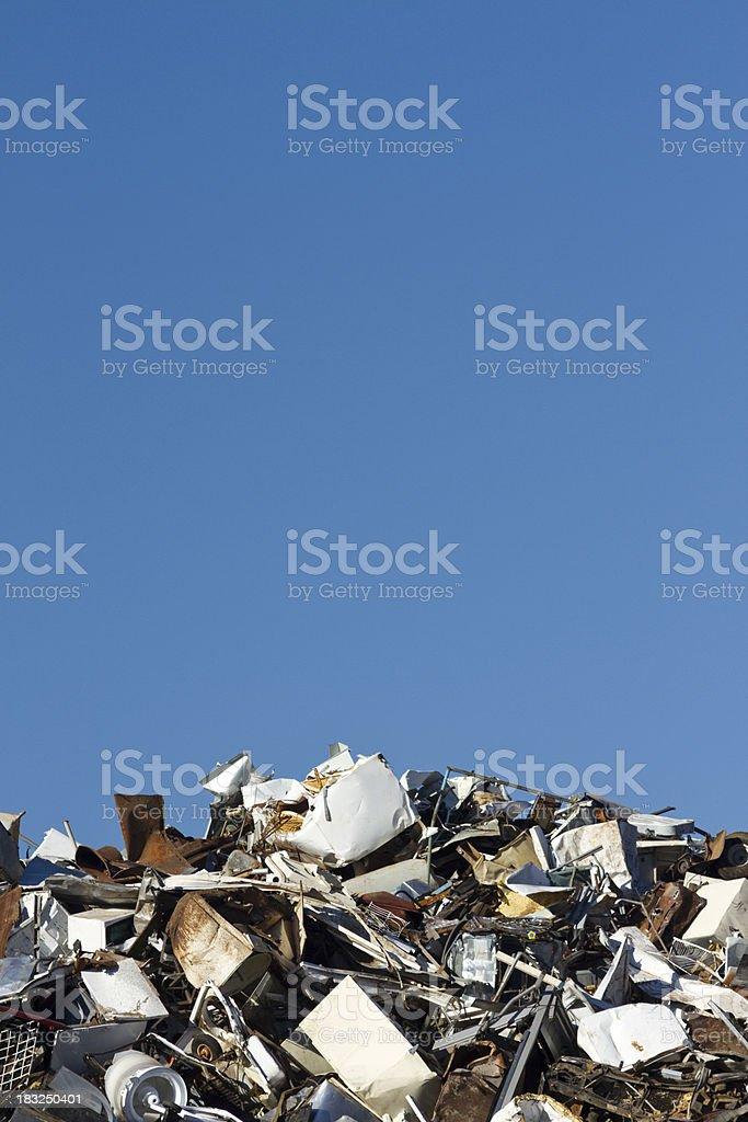 Metal Recycling Junkyard, Blue Sky Vertical, Low Horizon royalty-free stock photo
