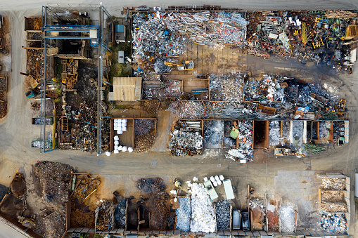 Directly above view of scrap metal yard.