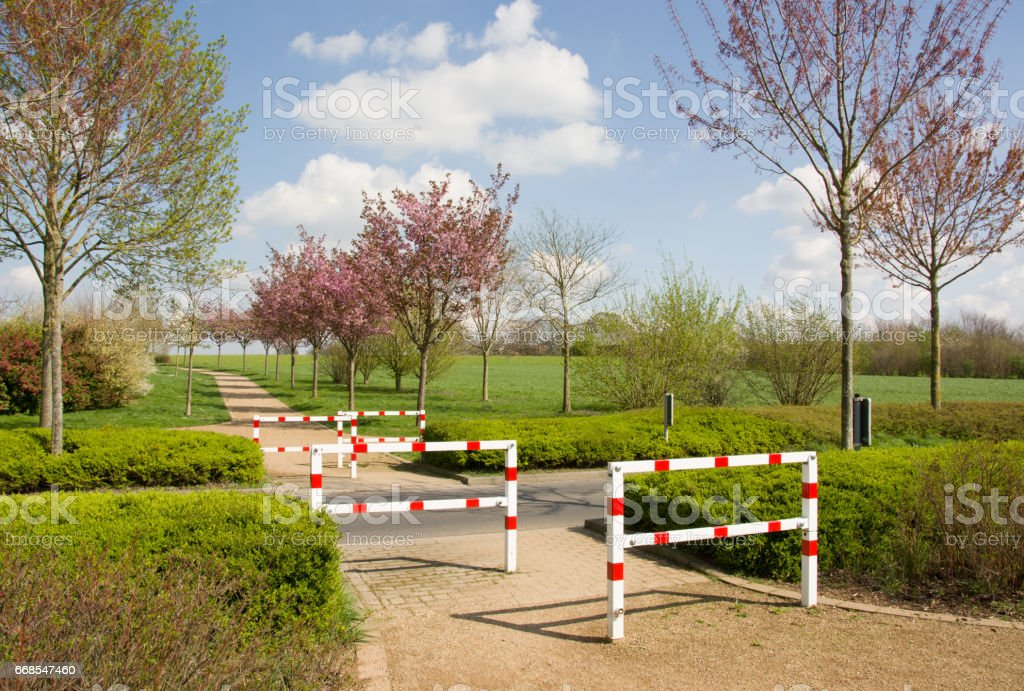 Metal red-white safety barriers outdoors. Road crossing for cyclists. stock photo