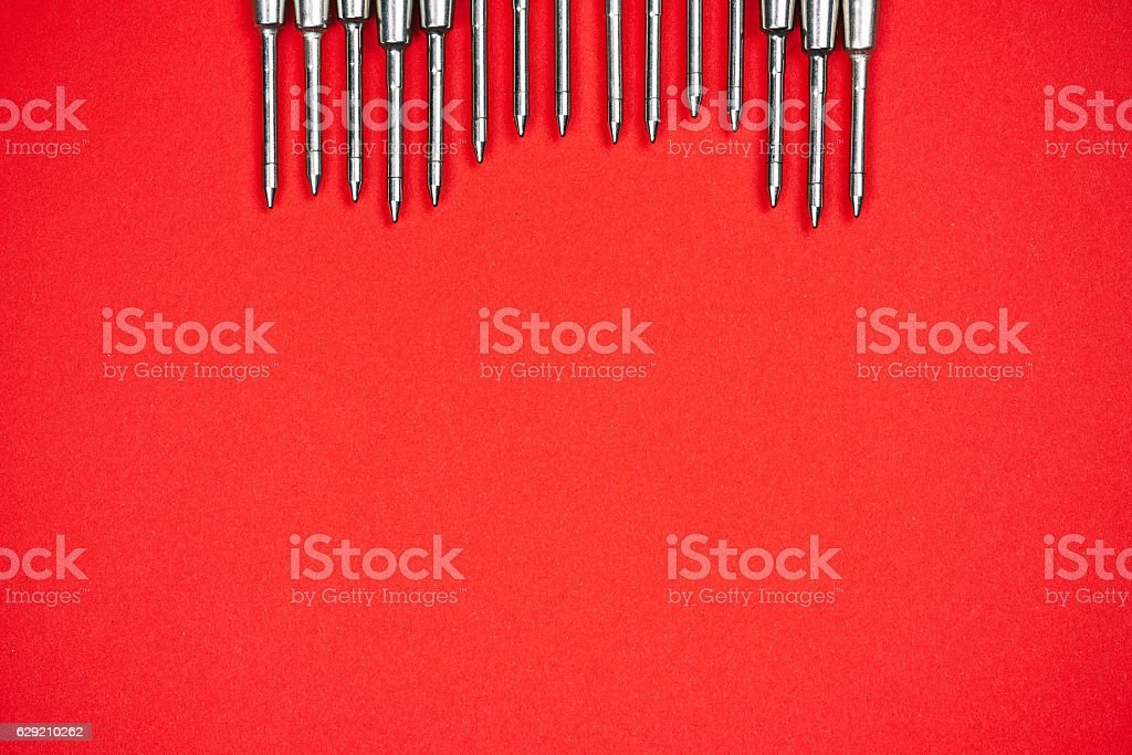 Metal refills on red stock photo