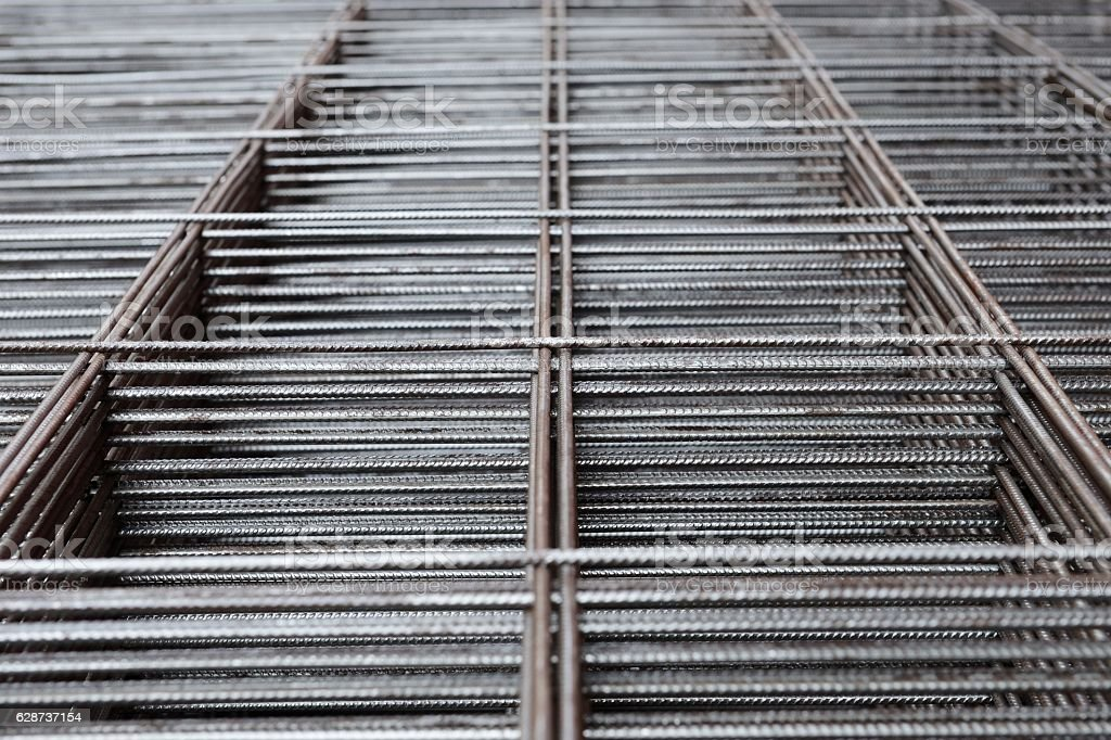 metal rods stacked in piles - Photo