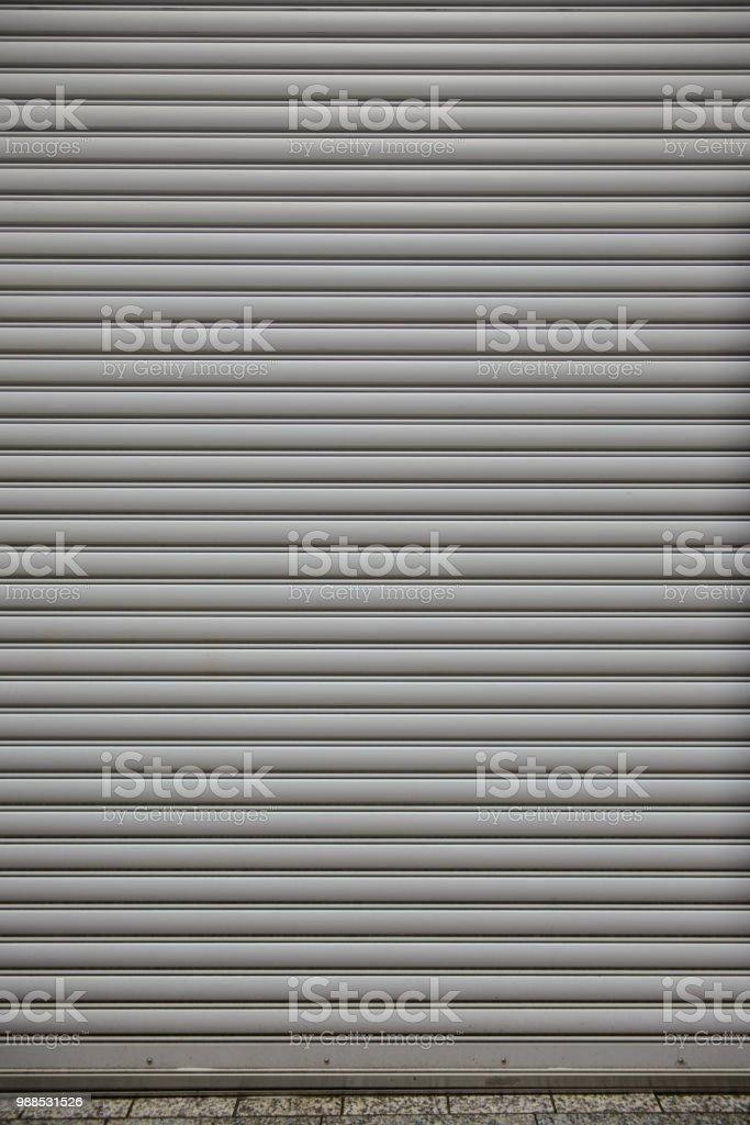 Metal roller shutter door of store closed.