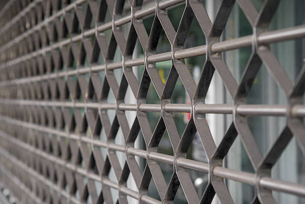 Metal rolling shutter blinds at store stock photo