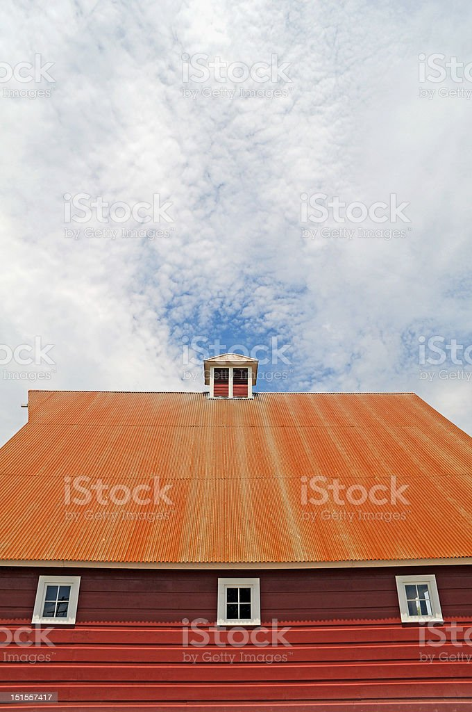 metal roof on a red barn royalty-free stock photo