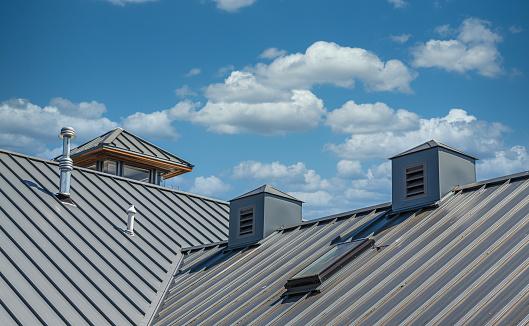 Ribbed Metal Roof Under Blue Skies