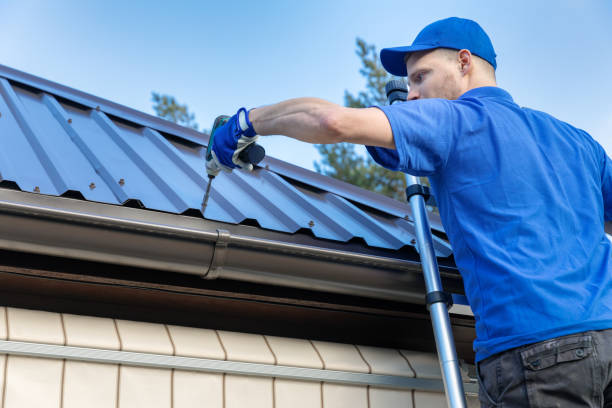 metal roofing - roofer working on the house roof stock photo