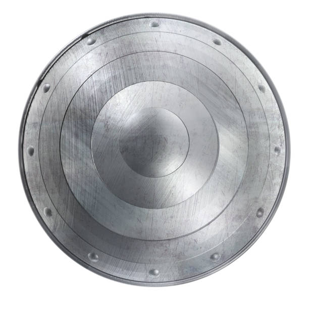 Metal Round Shield Image Round Shield Clipart Image with Scratched Metal Texture. Isolated on White. 3D Illustration with Clipping Path. shielding stock pictures, royalty-free photos & images