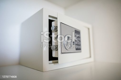 Metal safe inside an empty wooden closet in a hotel room