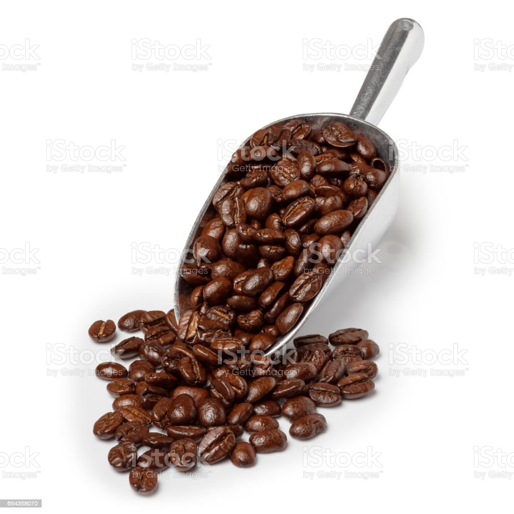 Metal scoop with roasted coffee stock photo
