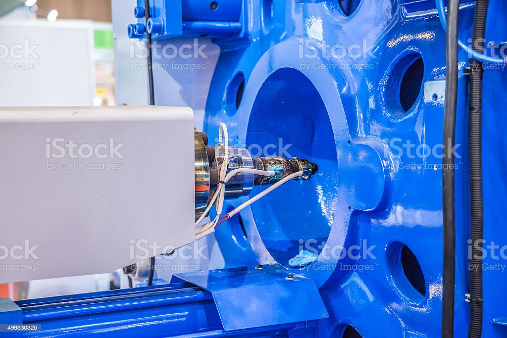 Metal screw components of the injection molding machine stock photo