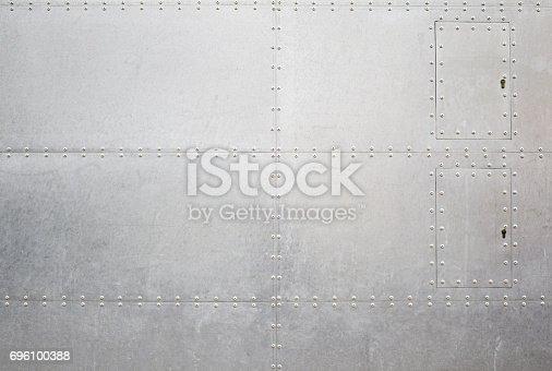 istock Metal screw Wall 696100388