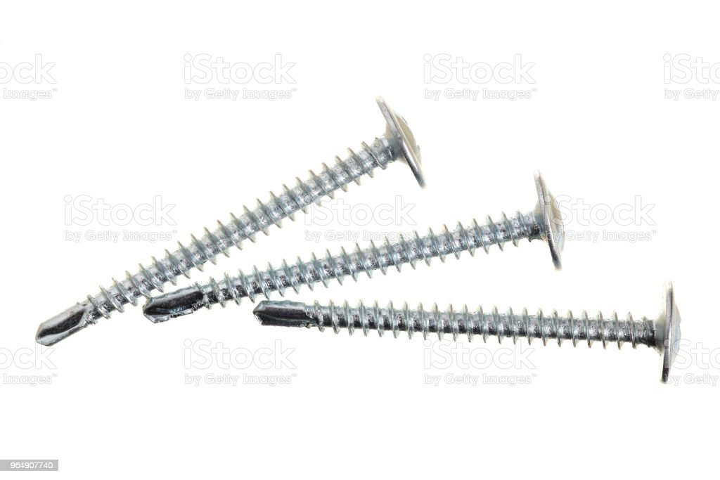 metal screws isolated on white background closeup. Top view royalty-free stock photo