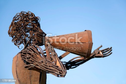 517780131 istock photo Metal sculpture shooting a movie scene with a megaphone 175195344
