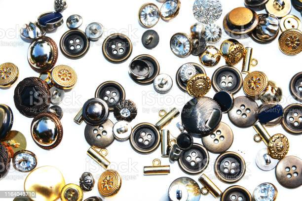 Metal sewing buttons of different sizes and shapes on an isolated picture id1164043710?b=1&k=6&m=1164043710&s=612x612&h=1o0 o hbmkcn6afdutglqelysns6pl2kzqp stqfube=