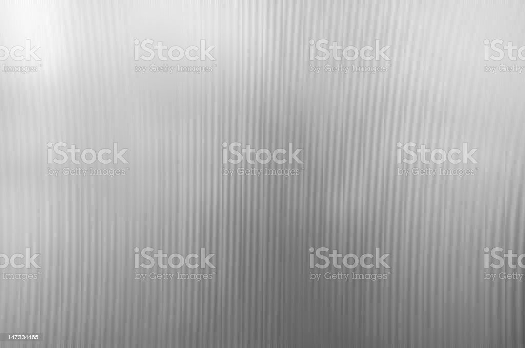 A metal sheath background that has light and dark gray hues stock photo