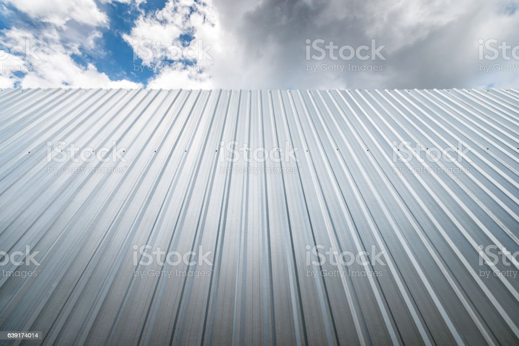 metal sheet wall against blue sky stock photo