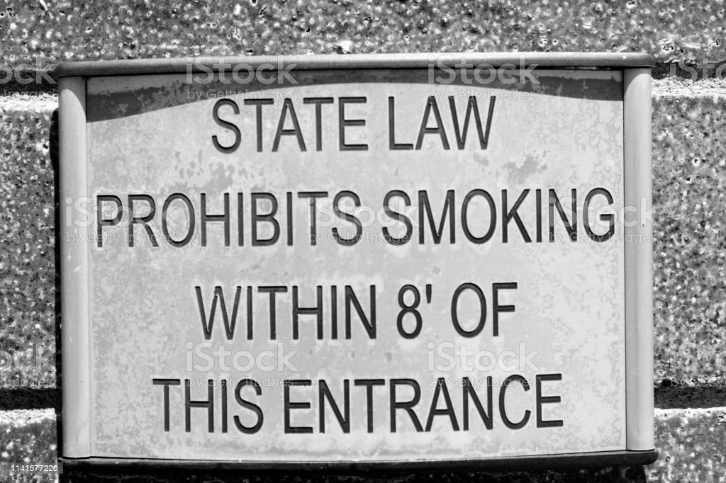 A metal sign displays a state law stock photo