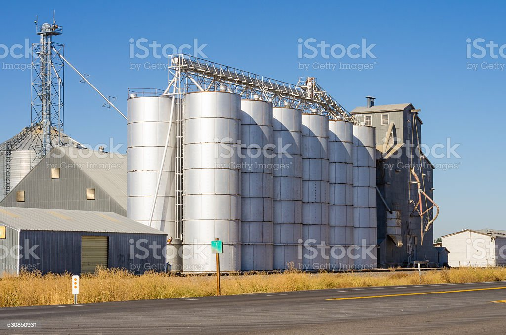 Metal silos and grain elevators stock photo