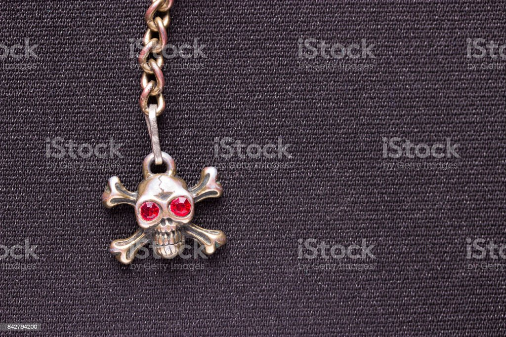 metal skull with red eyes stock photo