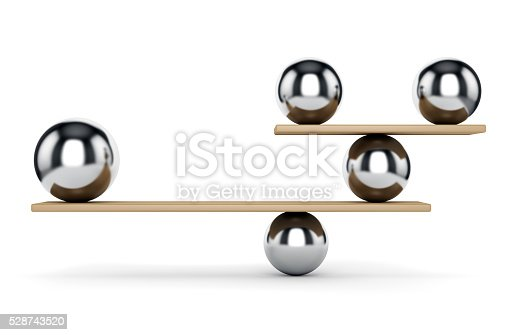 istock Metal spheres on scale 528743520