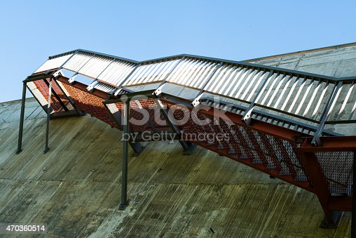 istock Metal stairs on the gray concrete wall 470360514