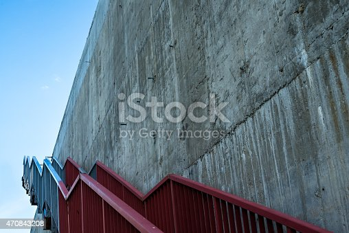 istock Metal stairs on the gray concrete wall 470843208