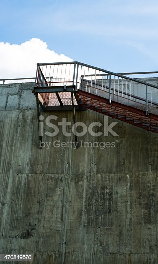 istock Metal stairs on the gray concrete wall 470849570