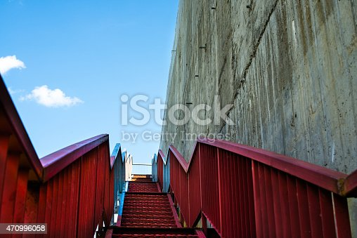 istock Metal stairs on the gray concrete wall 470996058