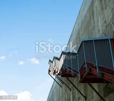 istock Metal stairs on the gray concrete wall 471018976