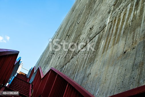 istock Metal stairs on the gray concrete wall 484496368