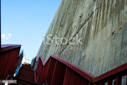 istock Metal stairs on the gray concrete wall 484623622