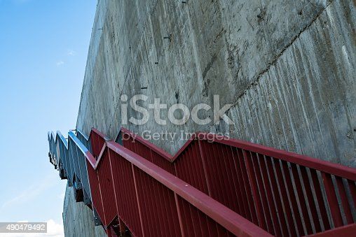 istock Metal stairs on the gray concrete wall 490479492