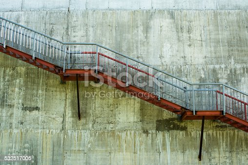 istock Metal stairs on the gray concrete wall 532517005
