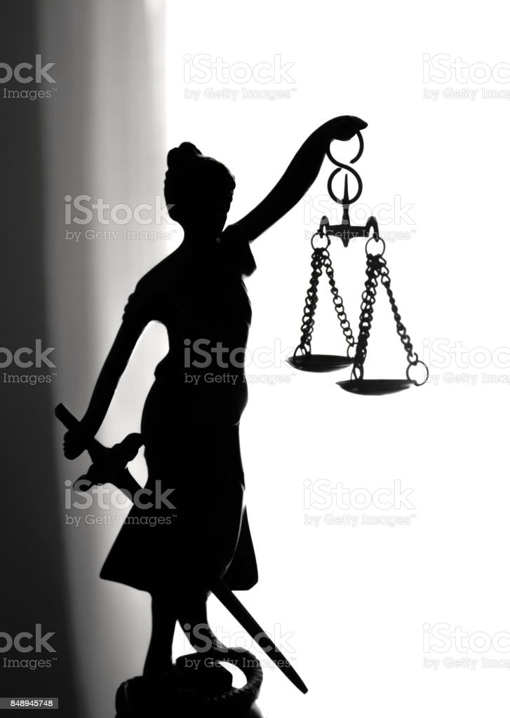 Metal statue symbol of justice Themis stock photo