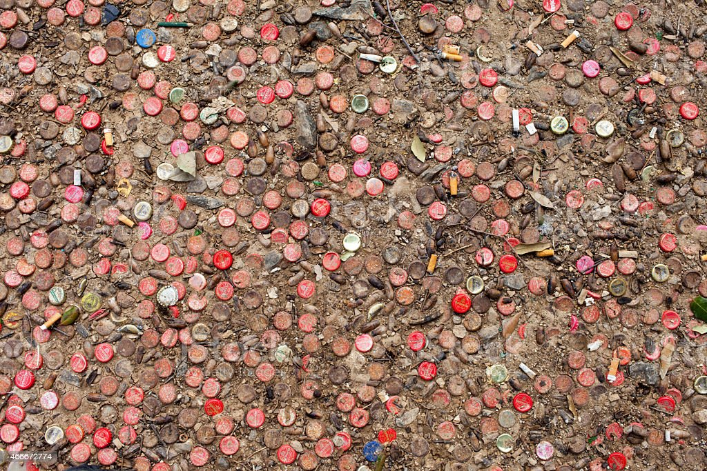 Metal stoppers on the ground, Mosaic. stock photo